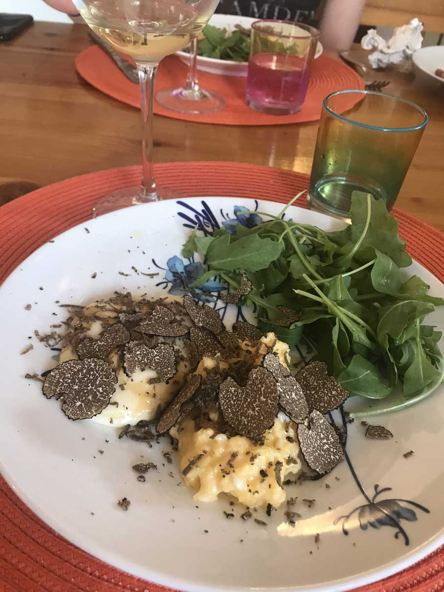 Plate of polenta with truffles and rocket salad