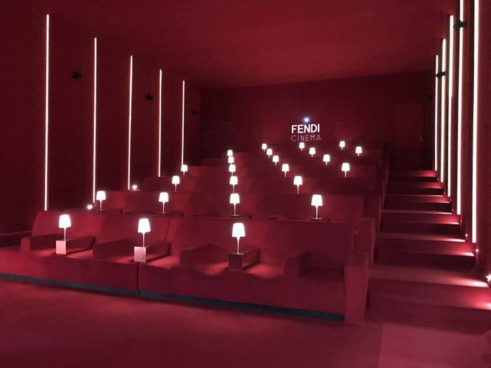Vintage red velvet screening room at Fendi Studios in Rome