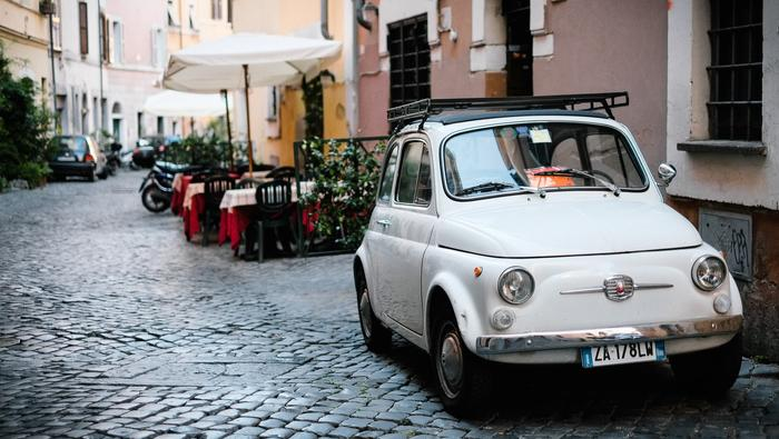 Small street in rome with vintage 500 fiat car