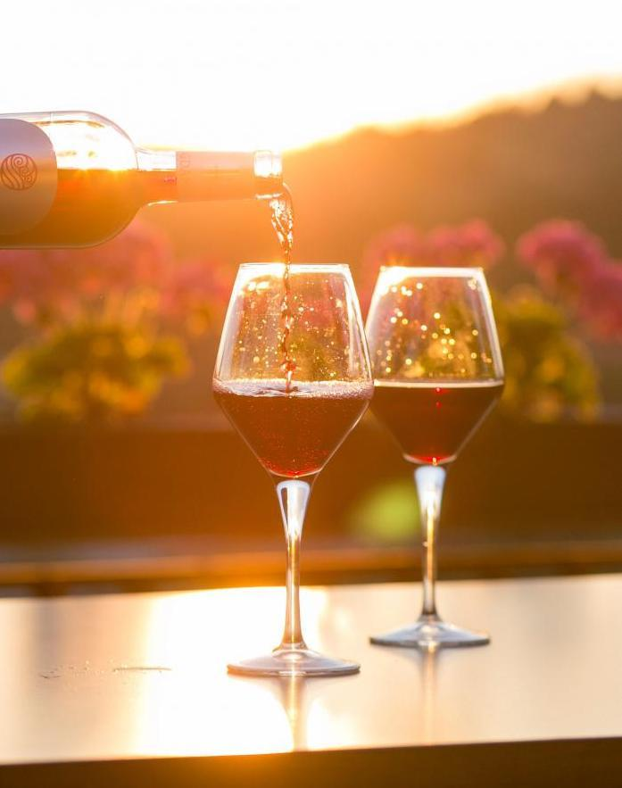 Two glasses of wine in sunset