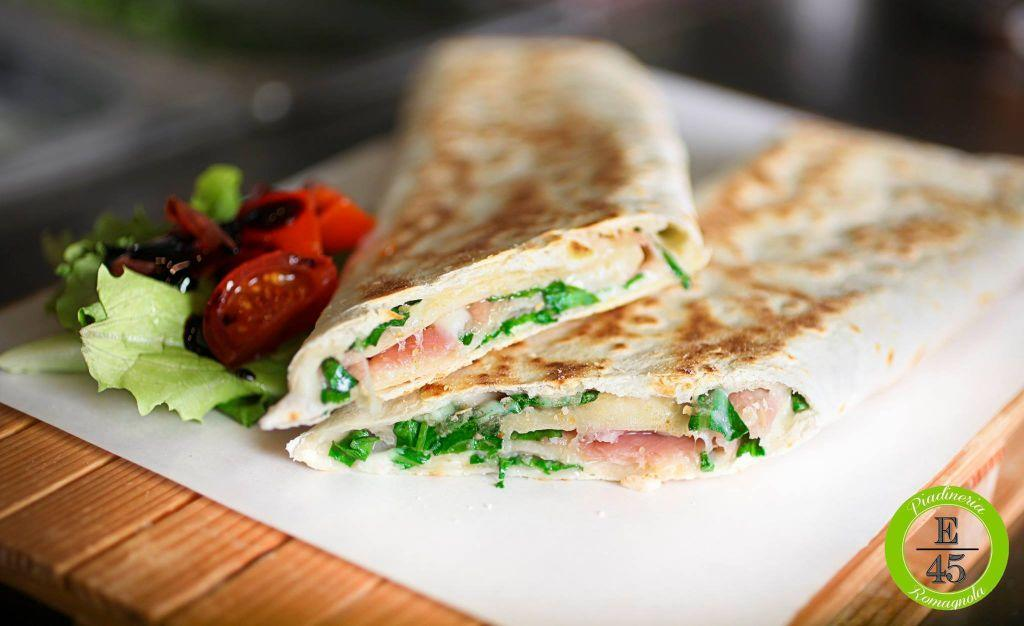A traditional Italian piadina filled with cheese, ham and fresh salad