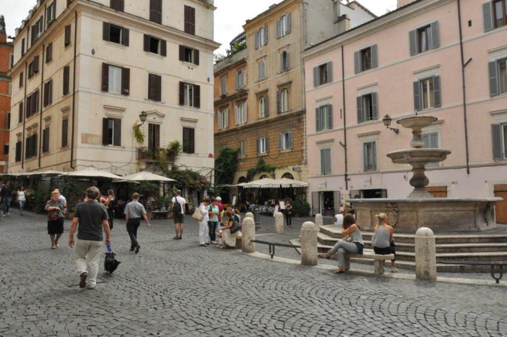 People walking around Piazza della Madonna dei Monti, Rome