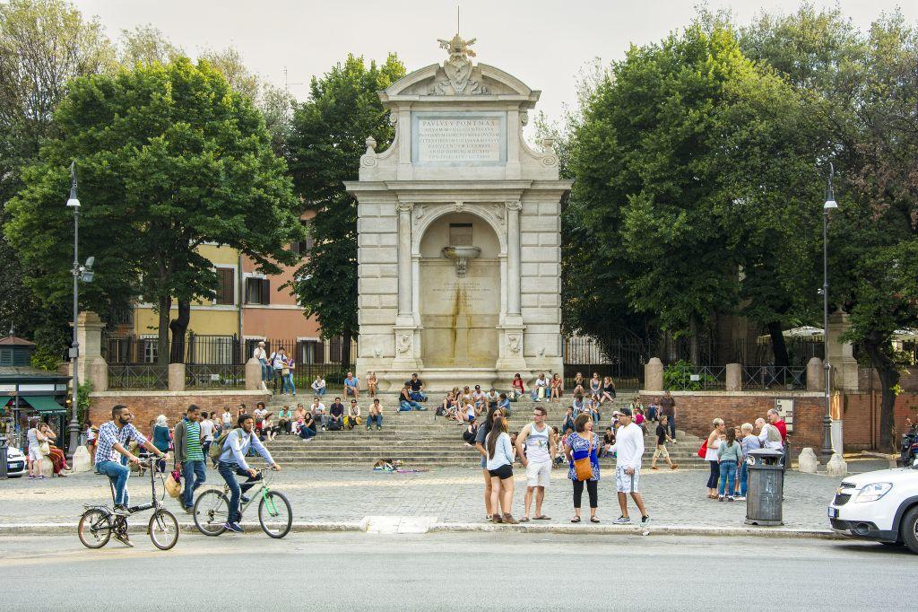 People enjoying themselves on a piazza in Rome