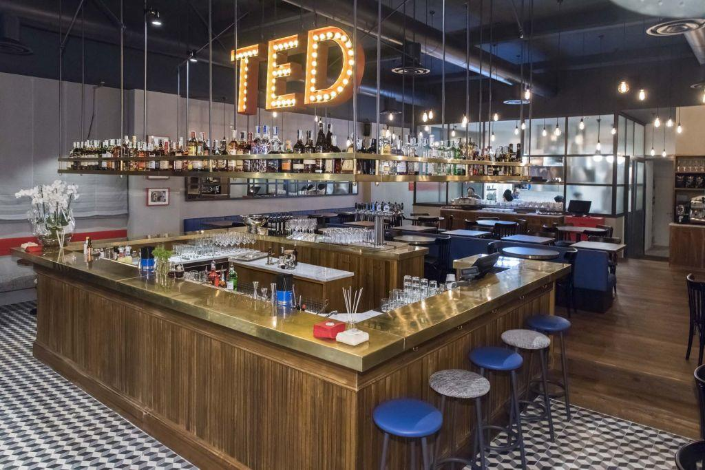 Central bar and sitting area at an exclusive burger restaurant Ted