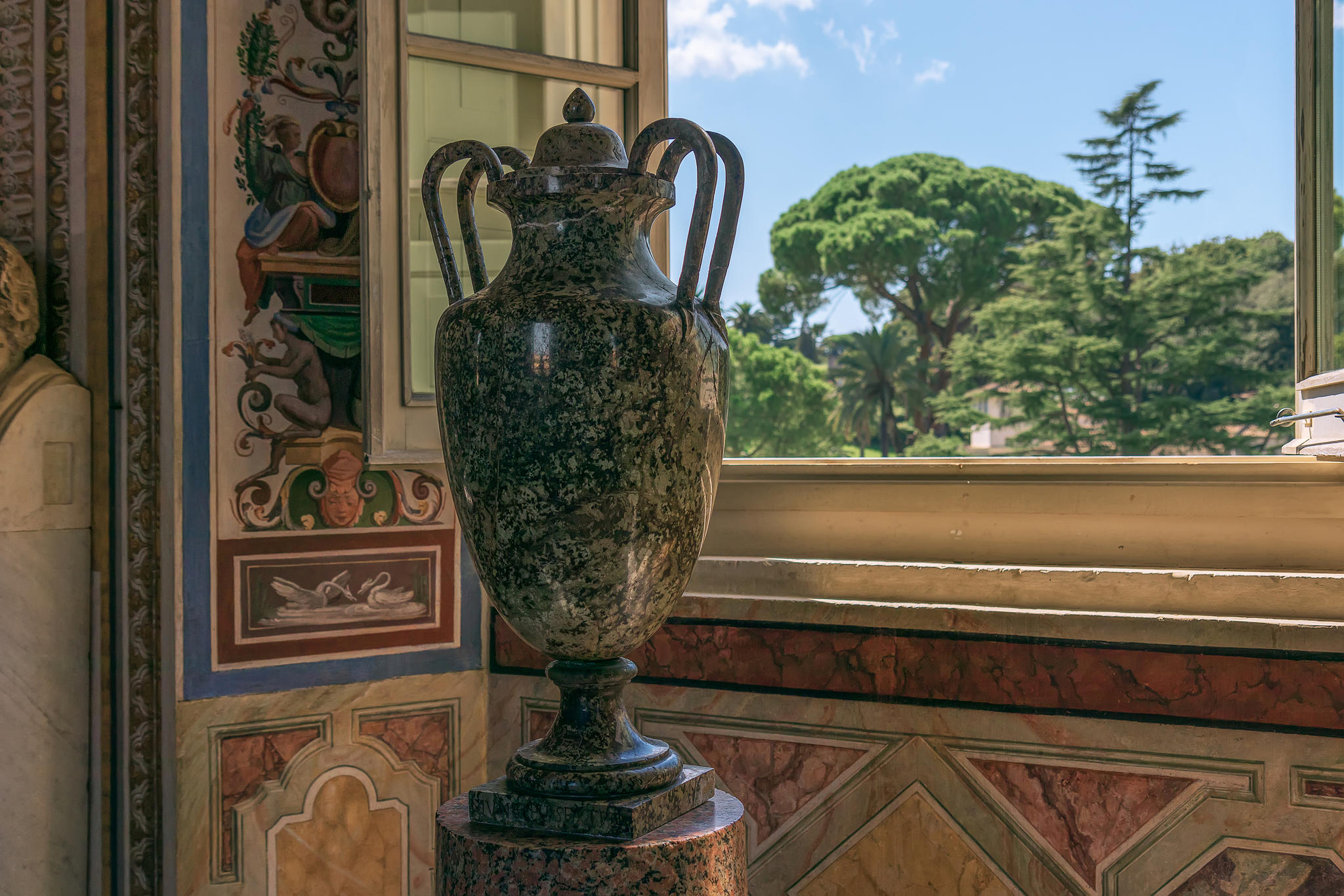 a vase from ancient rome with a view on the vatican