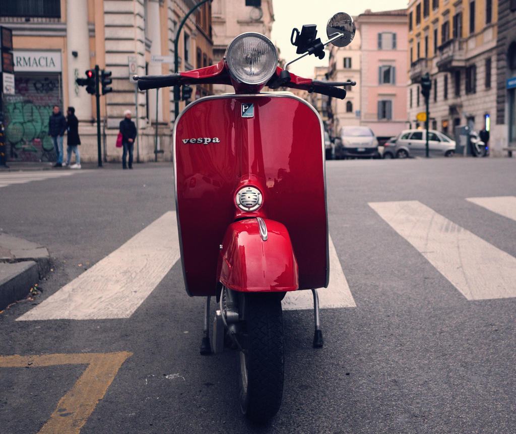 Red Vespa on the streets of Rome